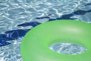 Green pool float in Clear Pool Water