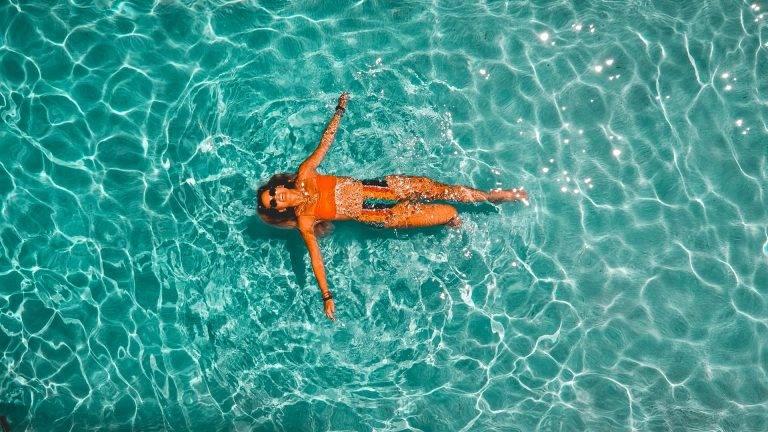 Lady relaxing in open water