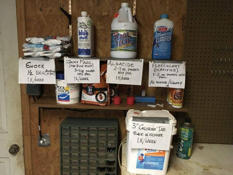 multiple pool chemicals on a shelf