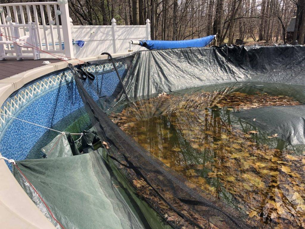 A leaf net installed over a pool cover can help with your pool opening this year.