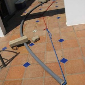 """Bending tubing. This is 2"""" SDR 17 and does not bend easily. I probably could have used elbows t"""